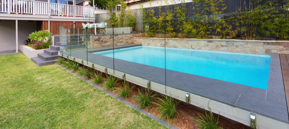 Lower north shore pool design with stone feature wall for Pool design sydney